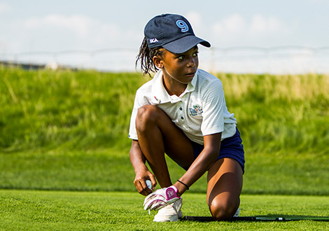 young golfer teeing up a ball