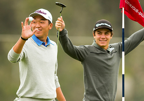 two young golfers smiling